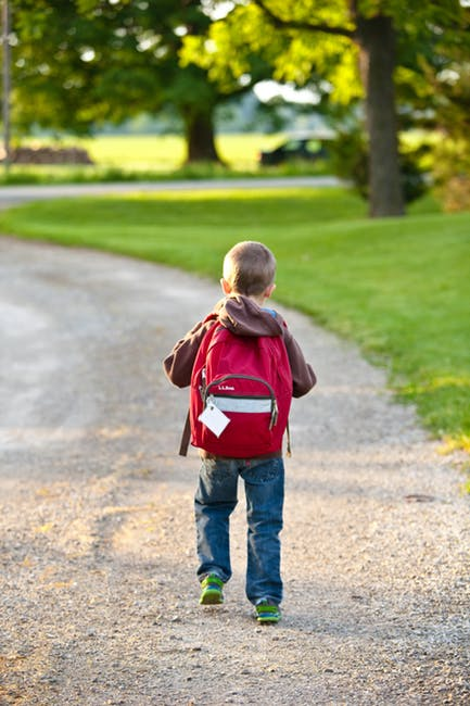 kid walkin to school